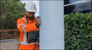 faiz khan investigating construction defects with UPV testing device
